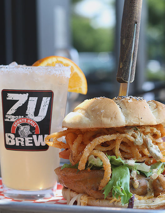 A Beer-Battered Bacon and Onion Burger with a Pink Zebra cocktail at The Zu Sports Grill (Cara Johnson)
