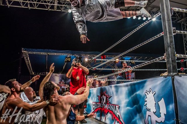 "Insane Clown Posse's Violent J launches over a wrestling ring at a past Gathering of the Juggalos. The Gathering features many sideshows, including wrestling events. (Dustin ""Hazin"" Lane / Cherry Bomb / provided)"