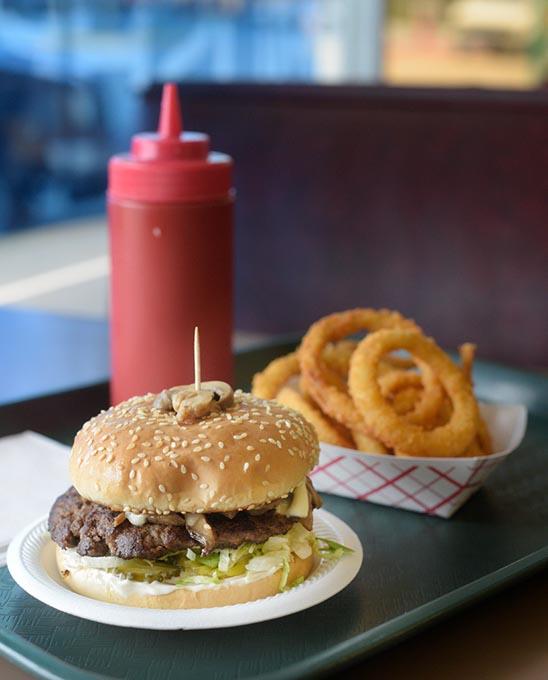 A mushroom burger and  onion rings  | Photo Garett Fisbeck
