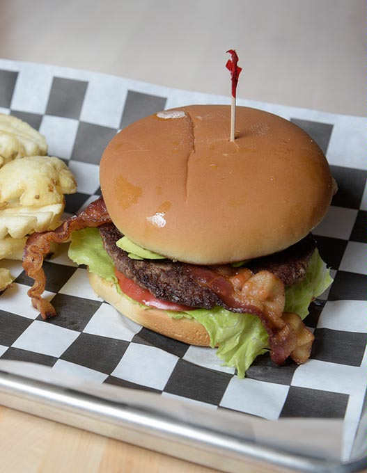 Aikman Bacon Avacado Burger with Waffle Fries at 1907 Burgers & Brews in Moore. (Garett Fisbeck)