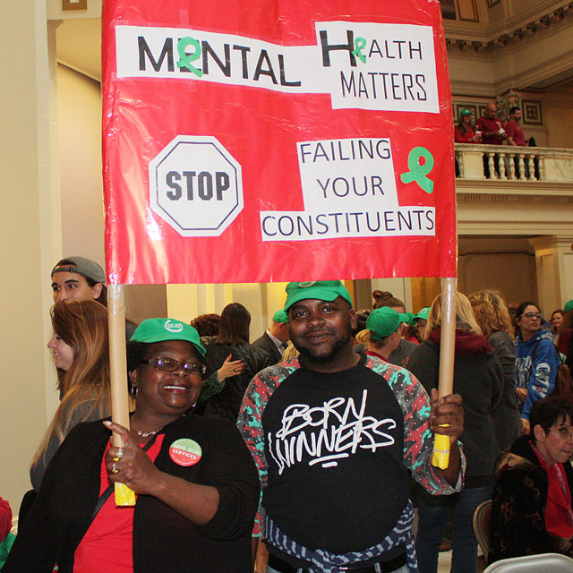Sharon Smith and Marlon Smith protest proposed cuts to the Oklahoma Department of Mental Health and Substance Abuse Services at the Oklahoma Capitol last week. (Laura Eastes)