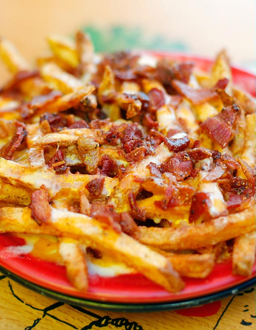Bacon cheese fries at Eskimo Joe's in Stillwater, Thursday, Aug. 6, 2015.  (Garett Fisbeck)