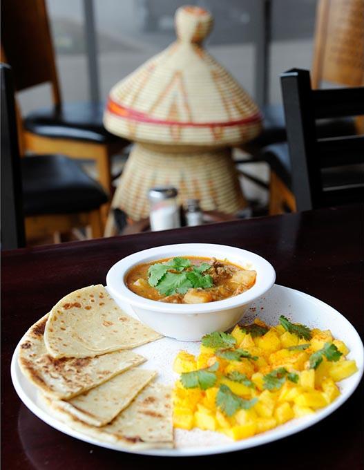 Kenyan <em>chapati</em> and beef stew at Haiget's Restaurant in Edmond (Garett Fisbeck / file)