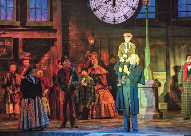 <em>center</em> Anthony Newmann plays Tiny Tim and Dirk Lumbard plays Ebenezer Scrooge in Lyric Theatre's <em>A Christmas Carol</em>. (KO Rinearson / Lyric Theatre of Oklahoma / provided)