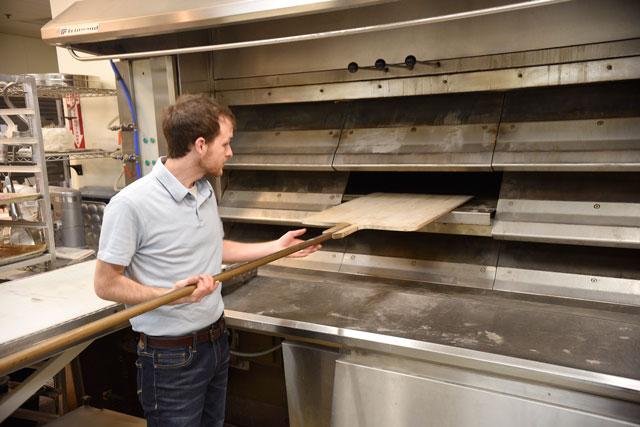 Baker Cameron Campbell shows off Esca Vitae's three-deck oven imported from France. (Jacob Threadgill)