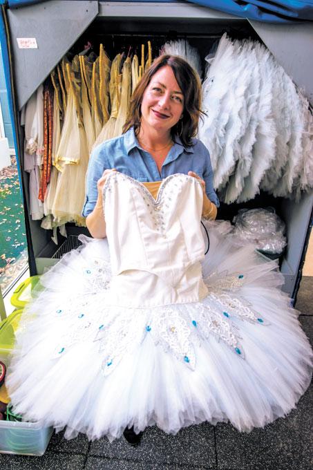 Dayna Brown goes through the Snowflake tutus used in Oklahoma City Ballet's <em>The Nutcracker</em>. (Mark Hancock)