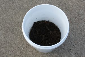 Start by filling a clean bucket 1/3 full of compost