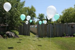 Floating balloons welcomed guests to the backyard.