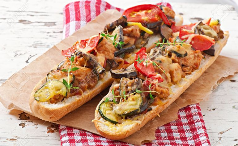 30376458-big-sandwich-with-roasted-vegetables-zucchini-eggplant-tomatoes-with-cheese-and-thyme-on-old-wooden-stock-photo