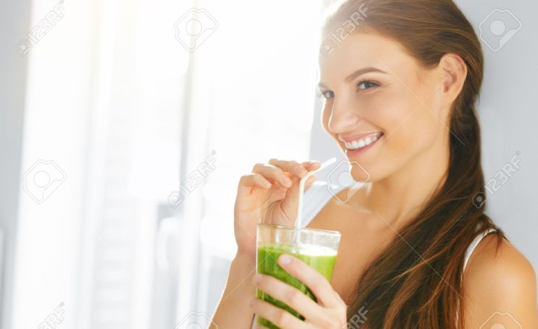 48201347-Organic-Food-Healthy-Eating-Woman-Drinking-Fresh-Raw-Green-Detox-Vegetable-Juice-Healthy-Lifestyle-V-Stock-Photo