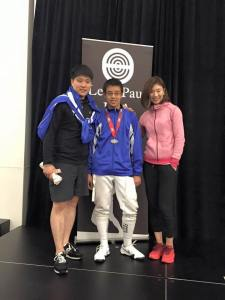 Coaches Kai Zhao and Shuang Meng with medalist Bin Huang, at the Summer Nationals 2015.