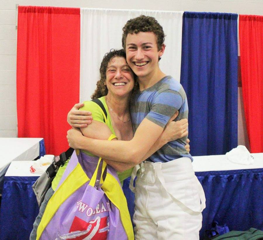 With his mom, at a fencing event