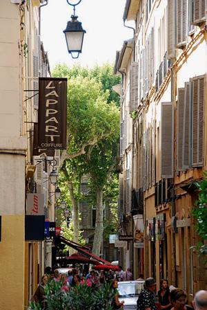 A narrow street of shops in Aix-en-Provence