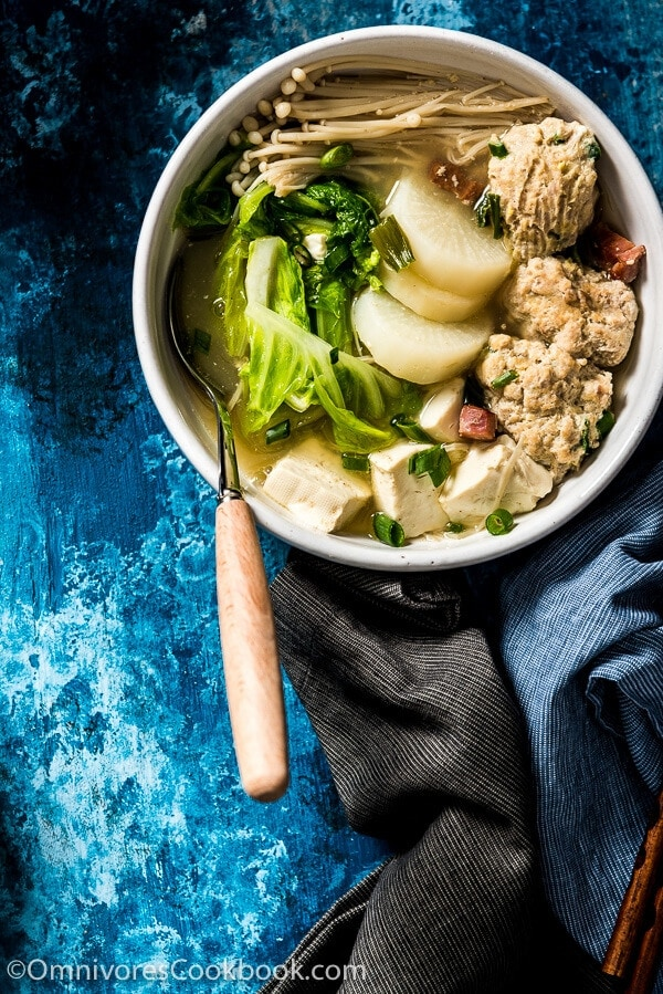 Napa Cabbage Soup with Tofu and Meatballs - Learn to cook the heartiest soup, plus two tips on how to quickly create a rich broth with just a few ingredients! | omnivorescookbook.com