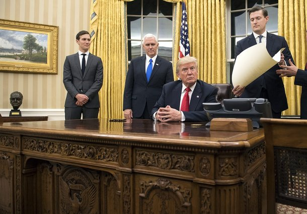 epa05736770 US President Donald J. Trump (C) prepares to sign a confirmation for Defense Secretary James Mattis, after Trump was sworn in as the 45th President of the United States in the Oval Office at the White House in Washington, DC, USA, 20 January 2017. Trump won the 08 November 2016 election to become the next US President.  EPA/KEVIN DIETSCH / POOL