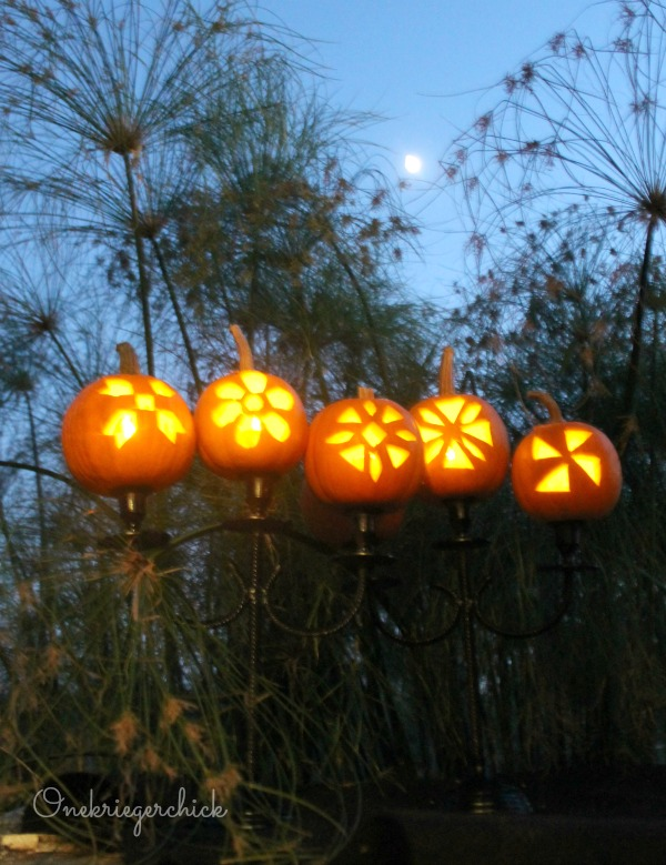 Carved Pumpkin Candelabra- How fun would this be at a Fall party!