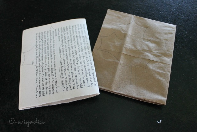 leaves traced onto book page and paper lunch sacks