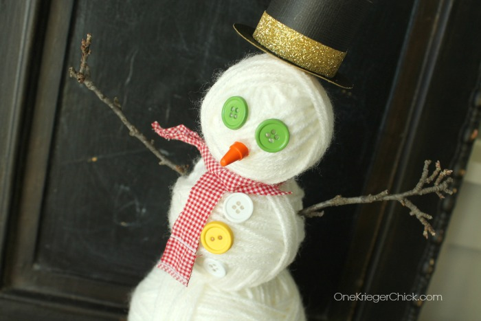 Snowman made from Yarn balls...so cute and kids can help make them! OneKriegerChick.com
