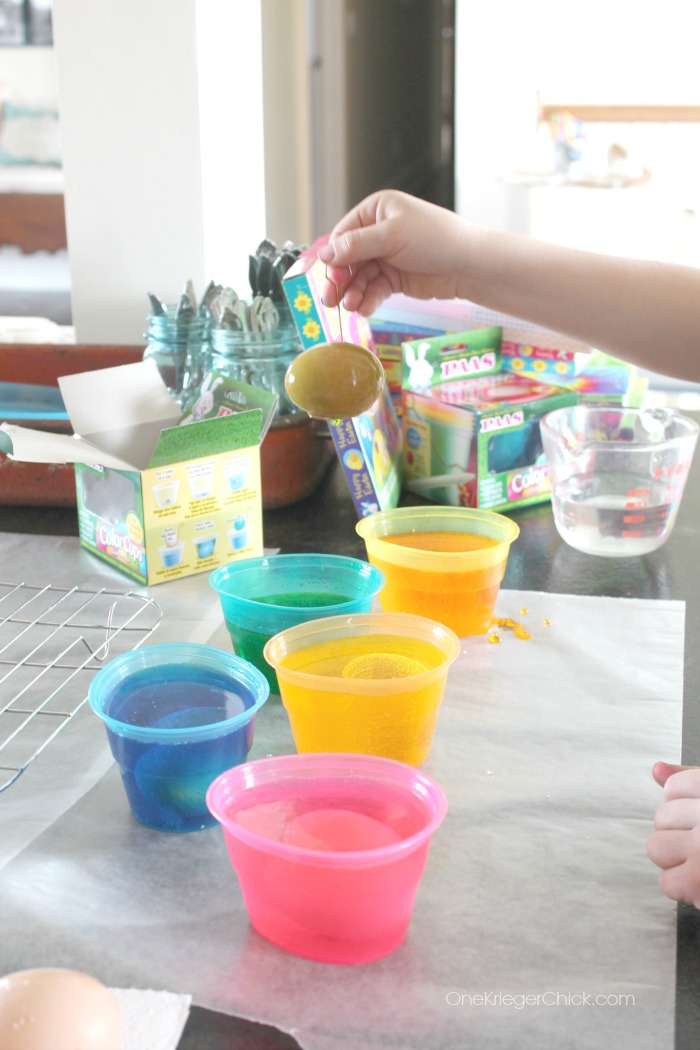 PAAS Egg dying kits are so easy to use- My 7-year old did it all by himself! OneKriegerChick.com