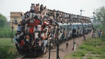 trains in india, riding outside a train, indian trains