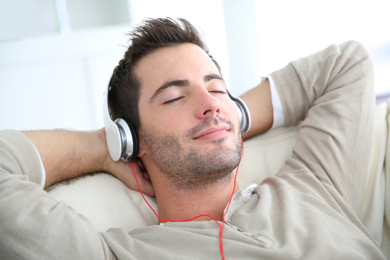 man listening to business soundscape