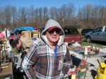 A vendor bundles up against the morning chill at Jamie's Flea Market