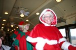 "Mrs. Claus and helpers on train from ""North Pole"""