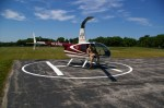 Helicopter pilot Kyle Mason getting ready to take off on a tour