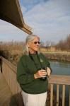 Mary Warren, Magee Marsh Naturalist, scans horizon for arrival of new birds