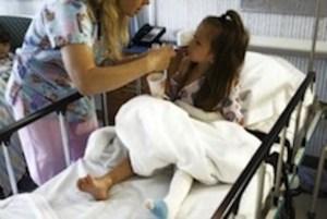 nurse wit child in hospital