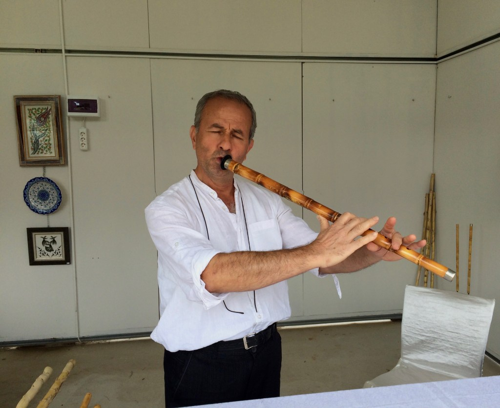 The pipe is nine sections long, and takes 1001 days to make, and sounds like a symphony of angels. This man, an engineer, makes and plays the pipes.