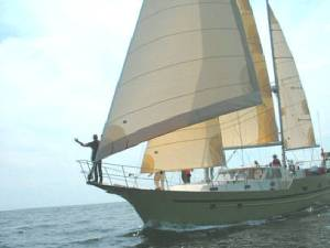 Llyr under sail - on the horizon line with rob and bri