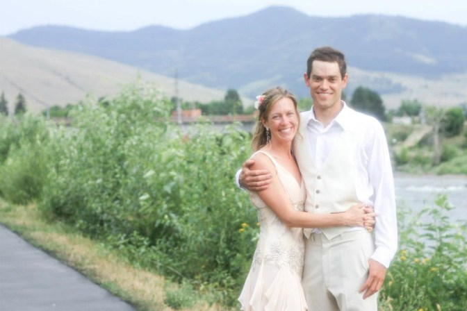 bri and rob by the clark fork river at our wedding in missoula - on the horizon line