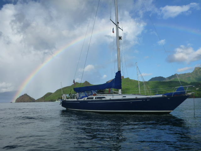 rainbow sailboat marquesas tropical island on the horizon line blog