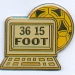 A lapel pin for the 36 15 Foot Minitel service.