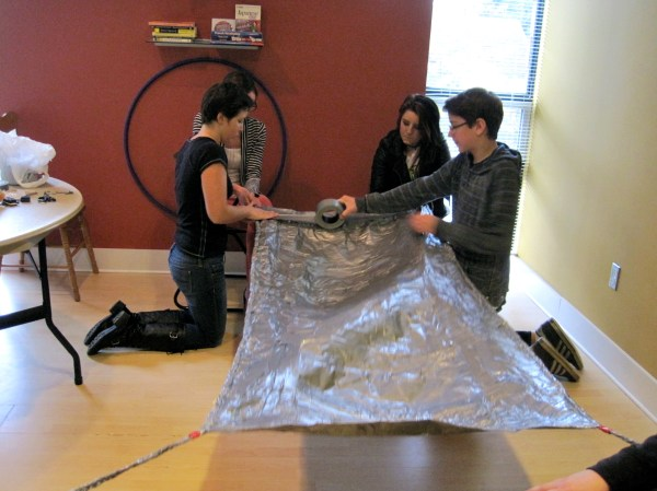 The finishing touches on the duct tape hammock!