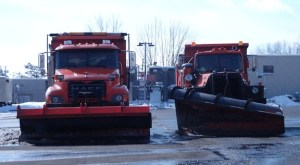 Orange Snow Plows stood at the ready Tuesday afternoon in anticipation of storm Derby.
