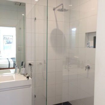 Stunning new modern ensuite for new master bedroom with hand selected fittings and inset shower shelf.