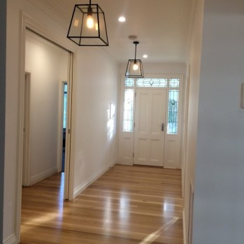 Spacious and inviting new entry with Tassie oak flooring, modern pendent lighting and stunning leadlight features for new entry.