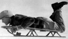 Boy_on_snow_sled,_1945