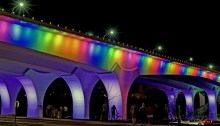 Interestate 35W Bridge in Minneapolis lit up in rainbow colors on June 12, 2016. Photo by MNDOT.