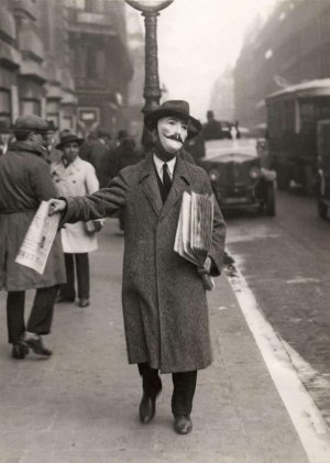 Newspaper Seller with a Mask in Paris, France, 1929