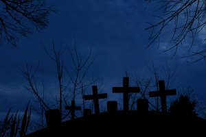 Silhouette of graveyard in the dark of halloween night with full moonlight