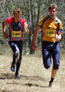 Rob Walter grimaces as he runs way from Simon Uppill in the finish chute.