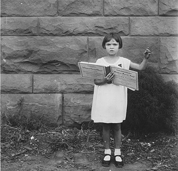 """Lorraine Miles, age six, led """"The Last Words of Copernicus"""" (p. 112 in The Sacred Harp) to win a gold piece in a children's singing contest at the 1930 Sacred Harp Singing Convention in Mineral Wells, Texas."""