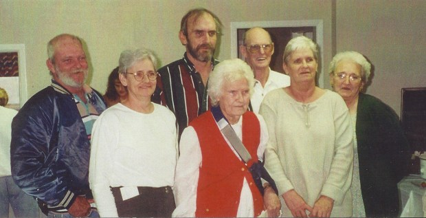 Gladys Wallace McGraw with her children on her 90th birthday. L to R Back: Gary, Ricky, Earlis, and Carlene, Front: Judy, Gladys, and Carolyn