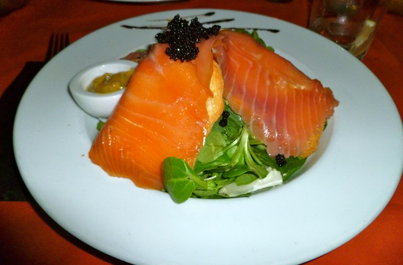 A delicious salmon salad I had at a restaurant along the beach in Malaga, Spain.