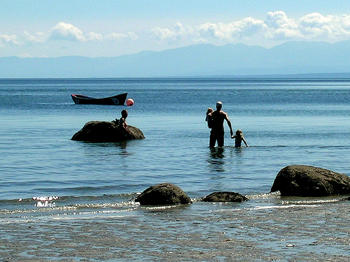 Family on Hollyhock Beach Cortes Island BC