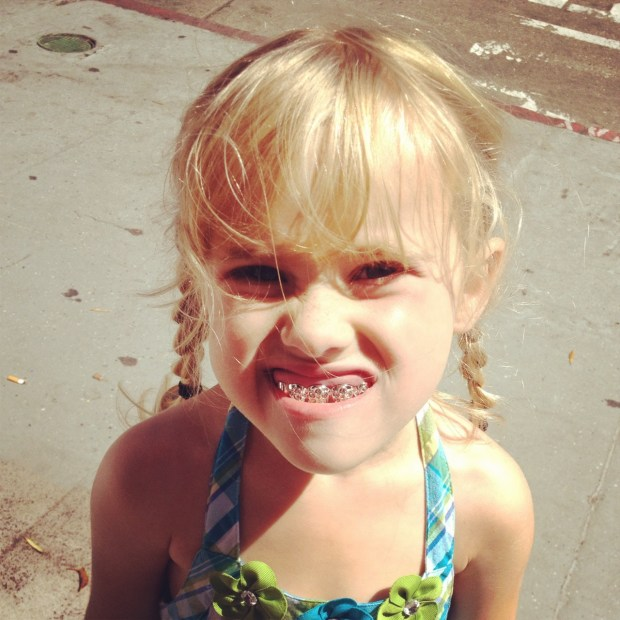 She saved her allowance for this lollypop grill.