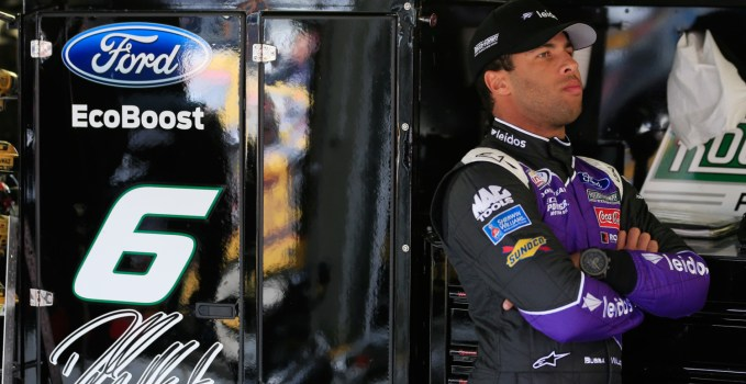 KANSAS CITY, KS - OCTOBER 14:  Darrell Wallace Jr., driver of the #6 Leidos Ford, stands in the garage area during practice for the NASCAR XFINITY Series Kansas Lottery 300 at Kansas Speedway on October 14, 2016 in Kansas City, Kansas.  (Photo by Chris Trotman/Getty Images)